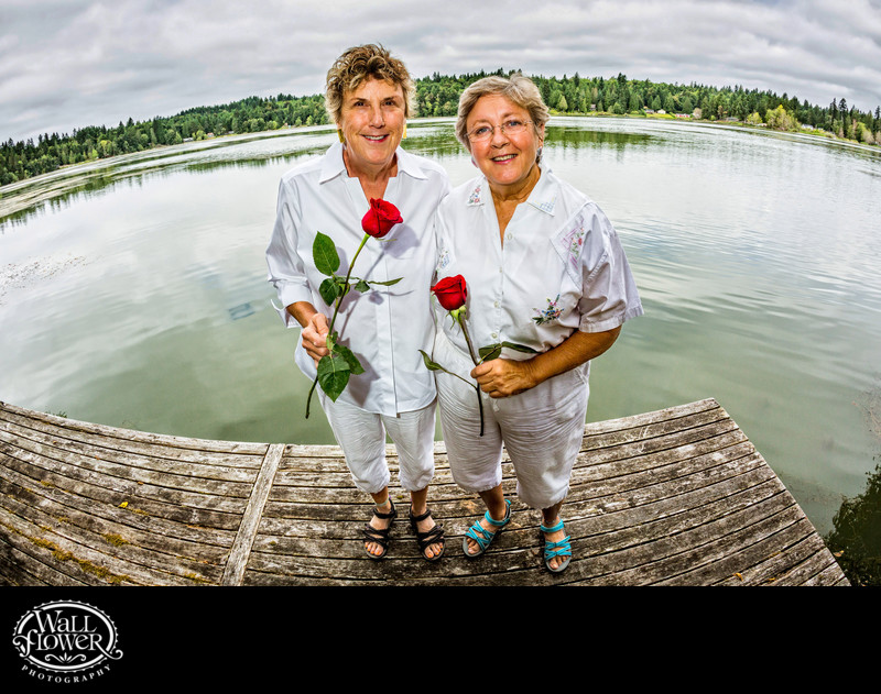 Two brides standing on Bay Lake dock on Key Peninsula