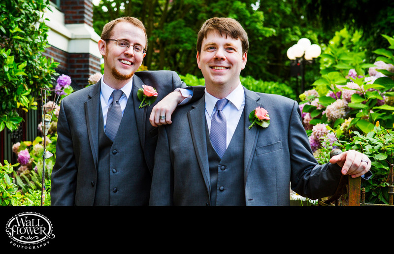 Two grooms posed in Shafer Baillie Mansion garden