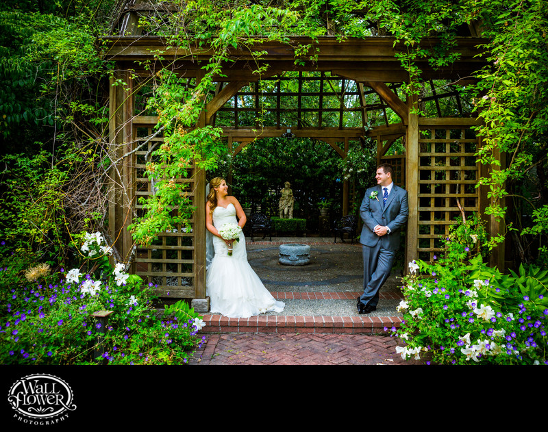 Bride and groom stand in Lakewold Garden teahouse