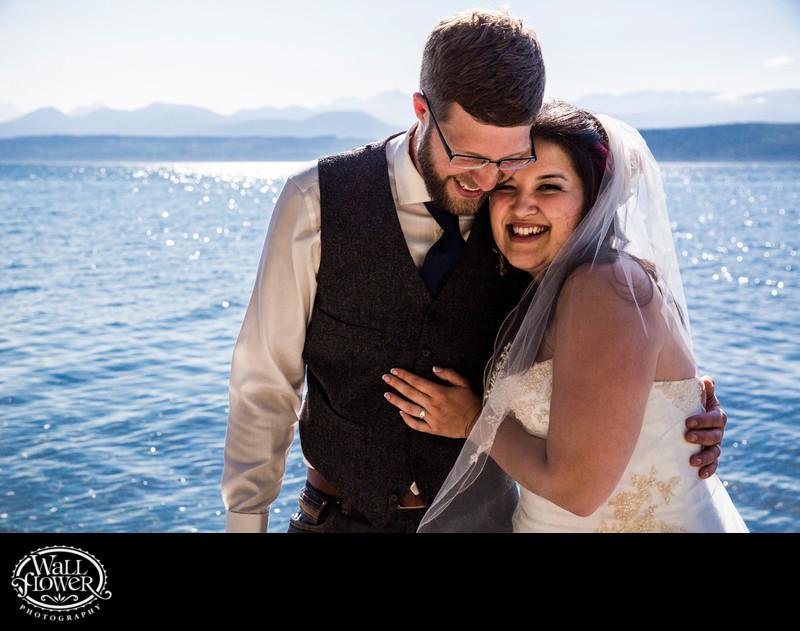 Bride and groom cuddle at Kitsap Memorial State Park