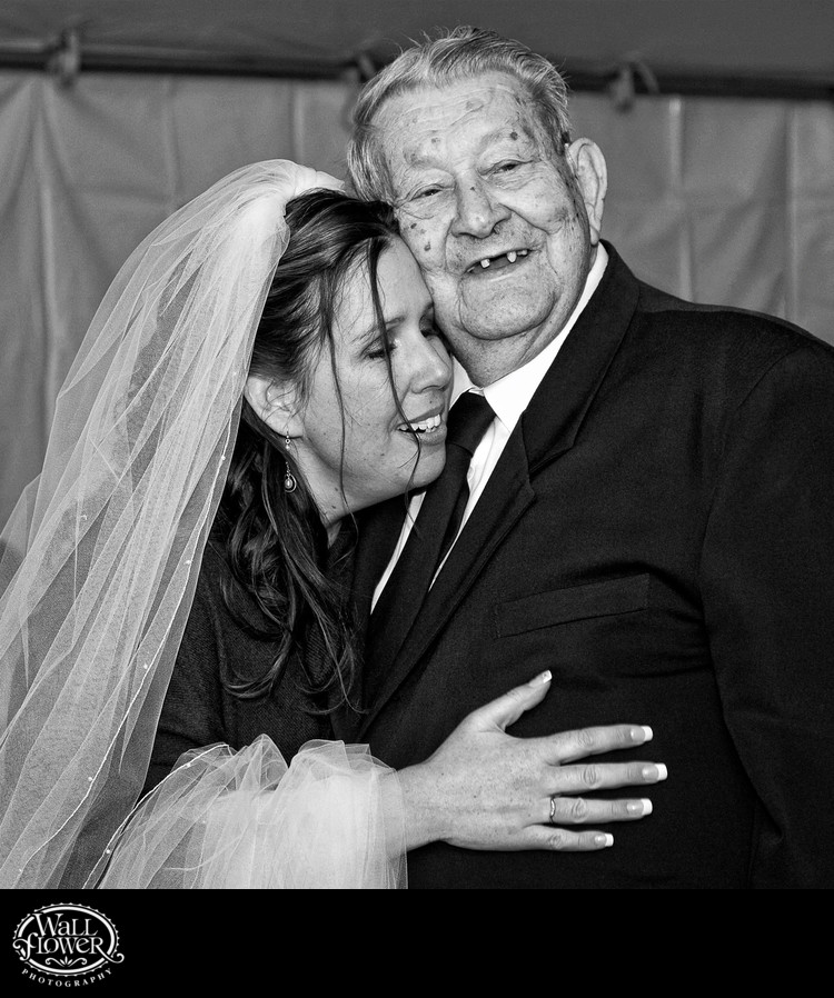 Bride hugs her grandpa during wedding reception at Copper Creek Inn in Ashford