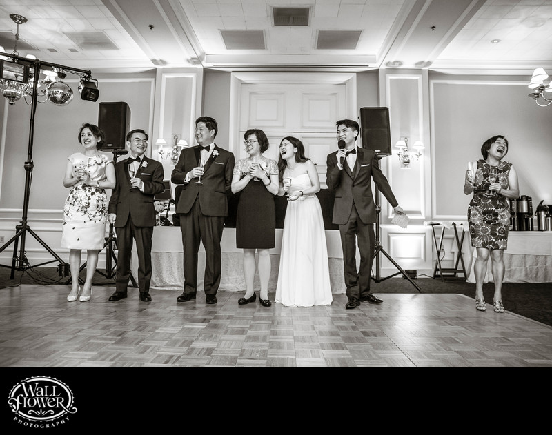Family of bride and groom laugh during toasts