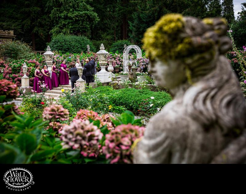 Statue watches wedding in Thornewood Castle garden
