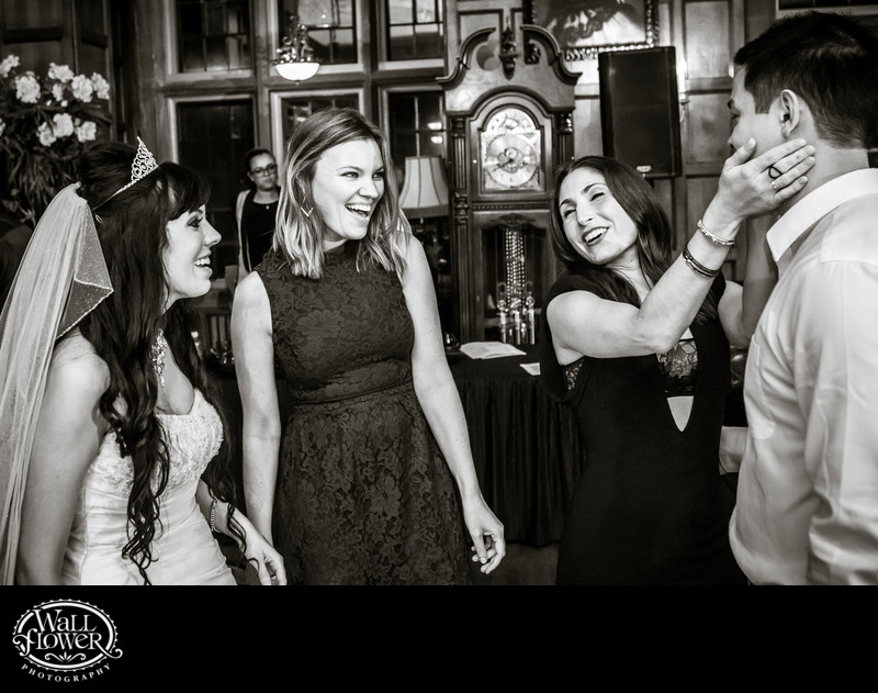 Bride and wedding guests having fun with boyfriend