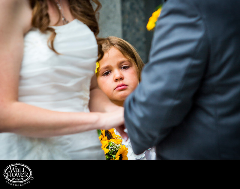 Flower girl watches ring exchange with tears