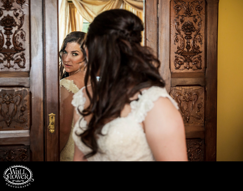 Bride gazes at reflection in Thornewood Castle mirror