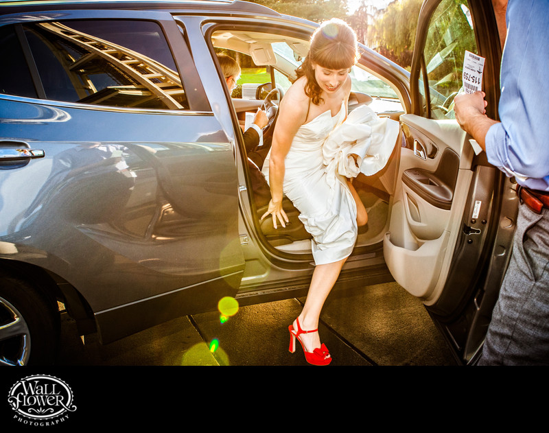 Bride steps out of car at Space Needle in Seattle