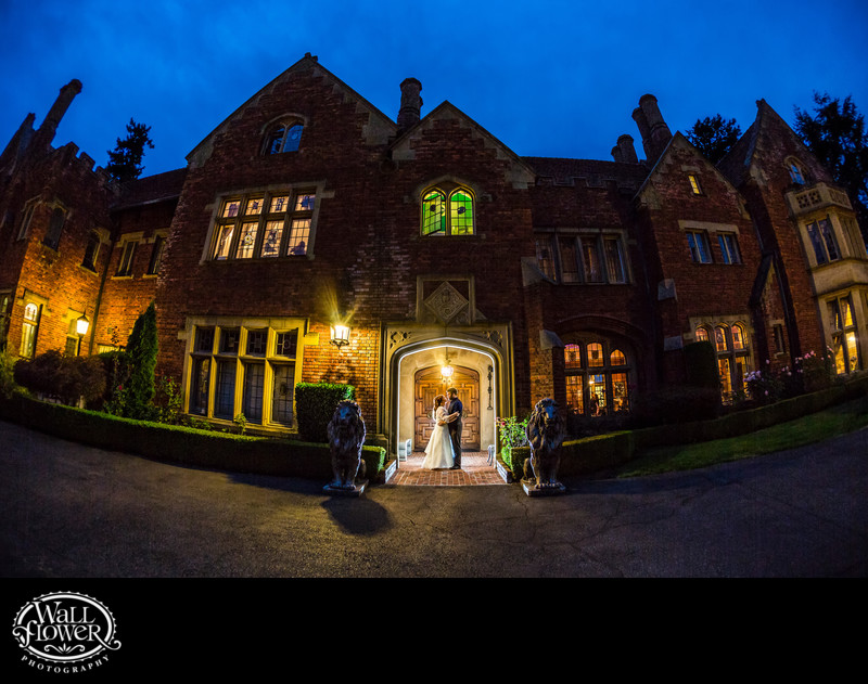 Bride and groom with lovely Thornewood Castle at dusk