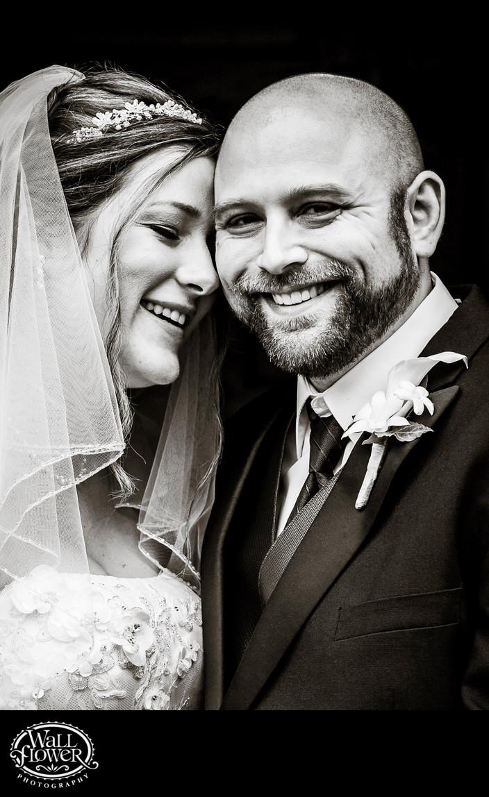 Bride and groom smile — skinny crop