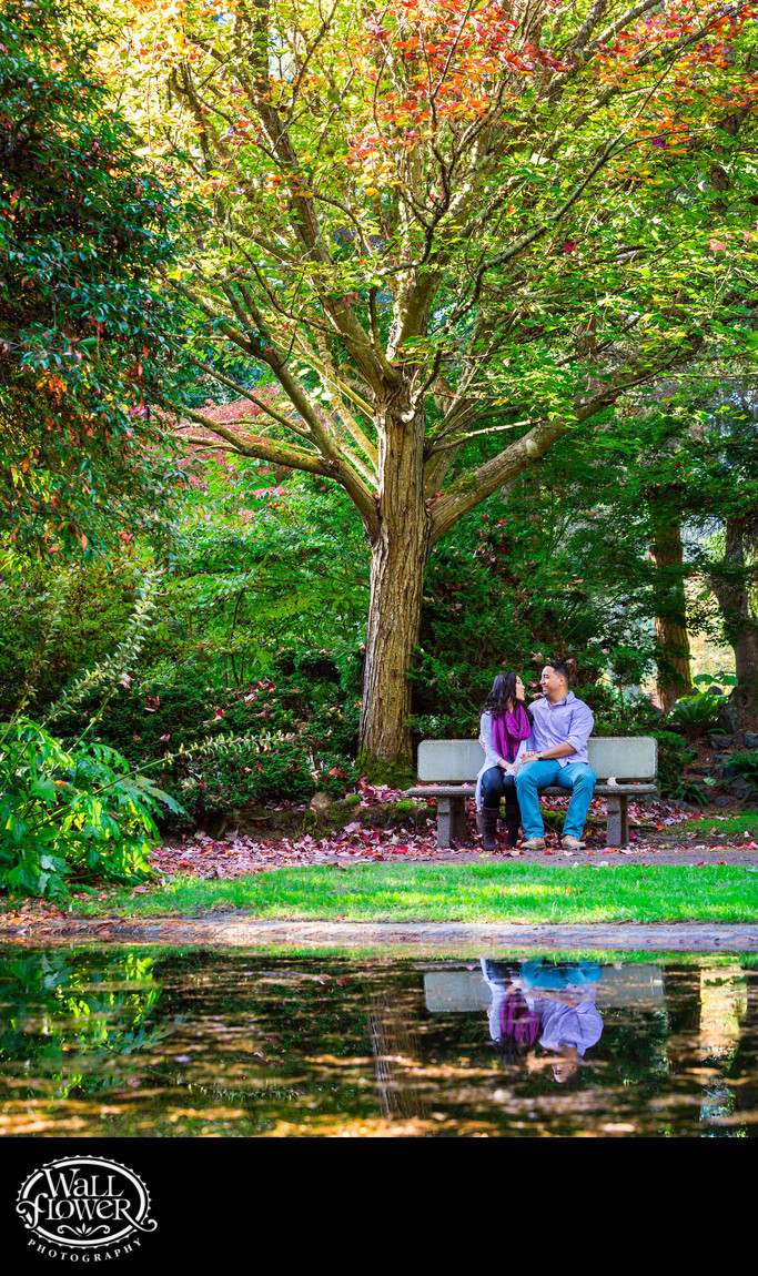 Engagement portrait with fall color and pond reflection