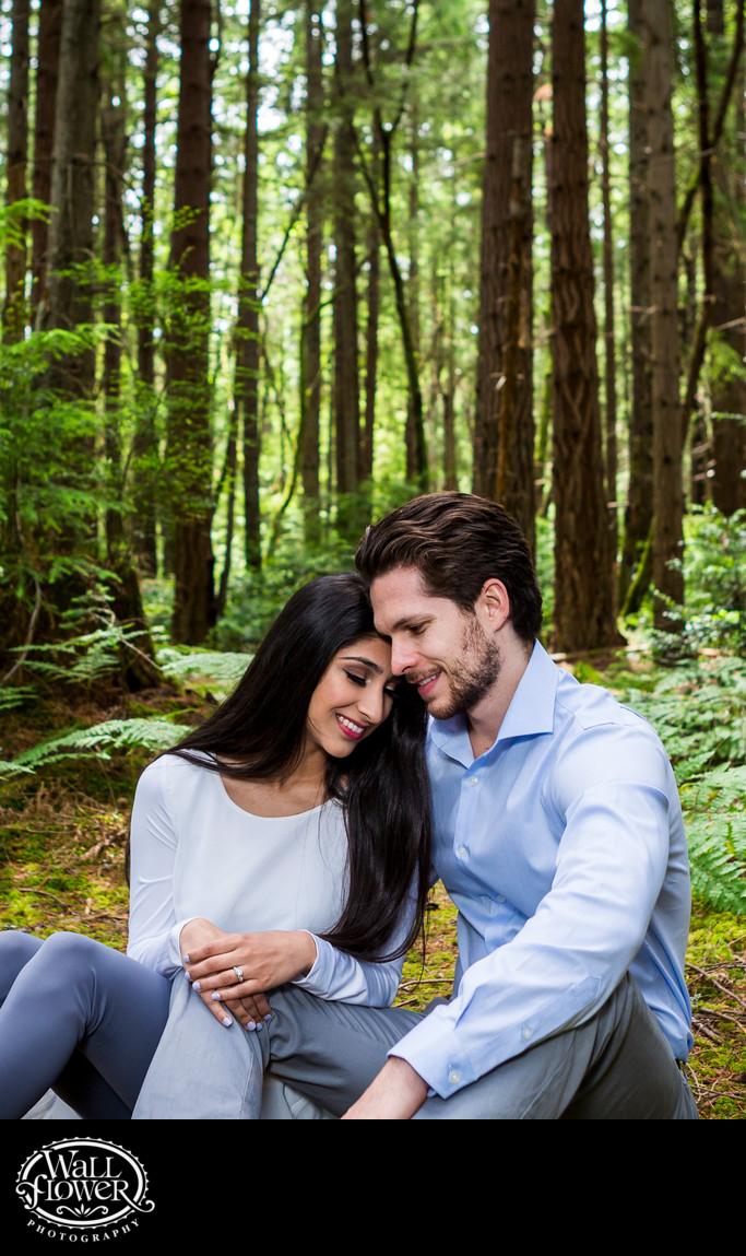 Engagement portrait cuddle in Point Defiance forest
