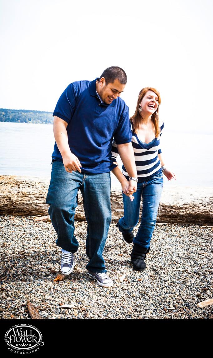 Engagement portrait stumble and laugh on Owen Beach