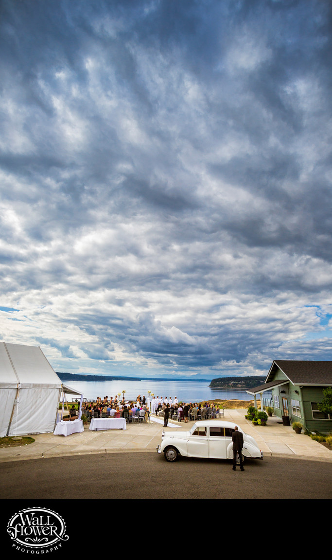 Wedding ceremony under cloudy skies at Chambers Bay