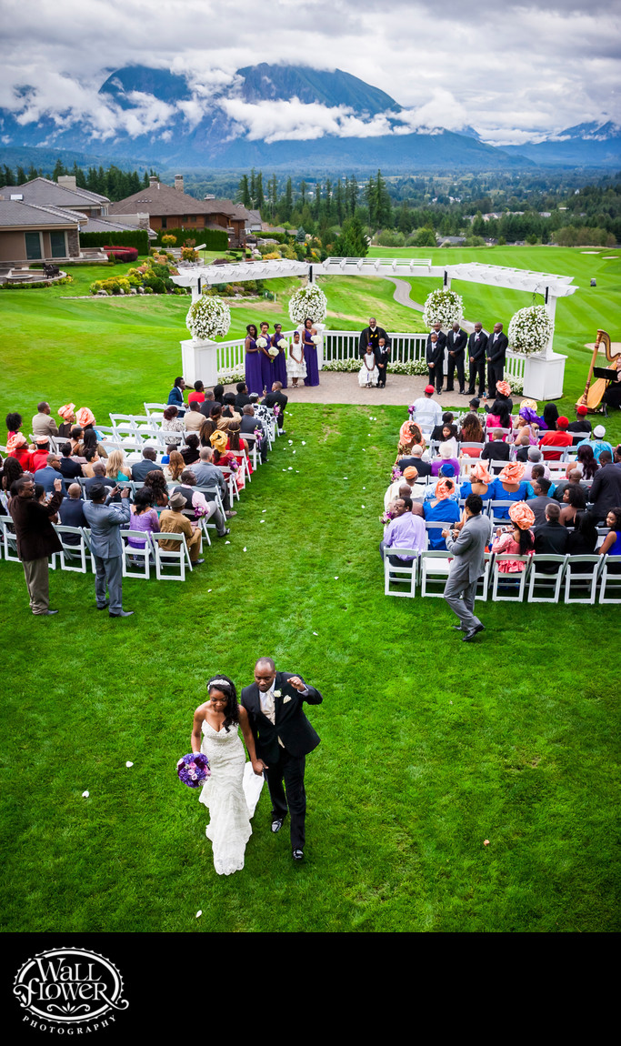 Fist pump after TPC Snoqualmie Ridge wedding ceremony