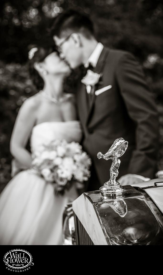 Detail of Rolls-Royce hood ornament with bride, groom
