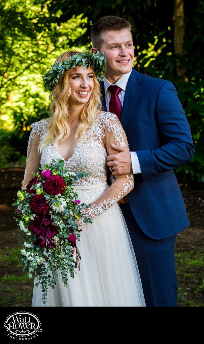 Bride and groom smile in studio-like wedding portrait