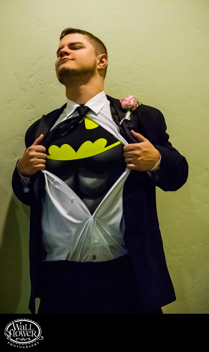 Groom pulls open shirt to reveal Batman chest plate