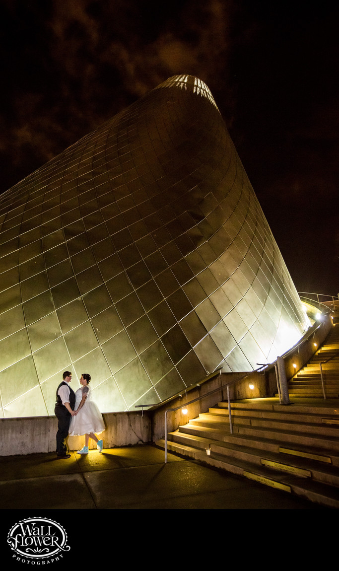 Brides pose by Museum of Glass Hotshop Cone at night