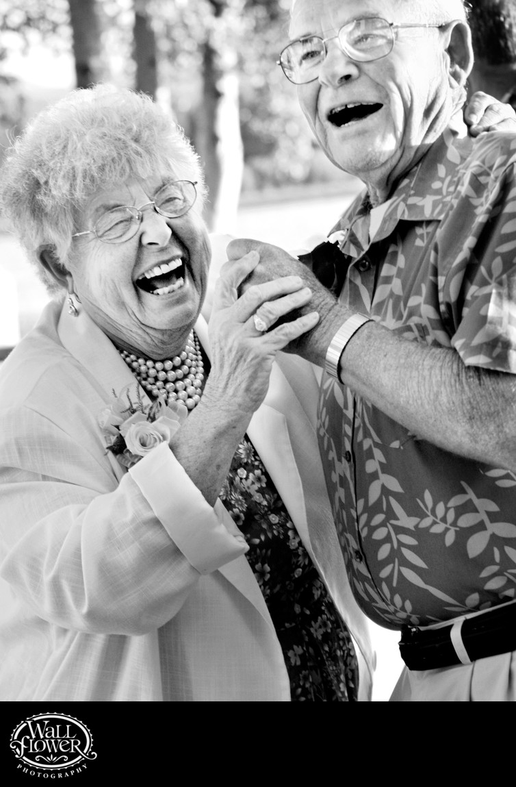 Grandparents smile while dancing in wedding reception