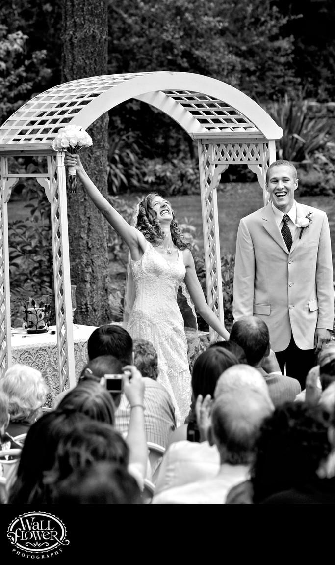 Bride celebrates exuberantly at the end of her wedding
