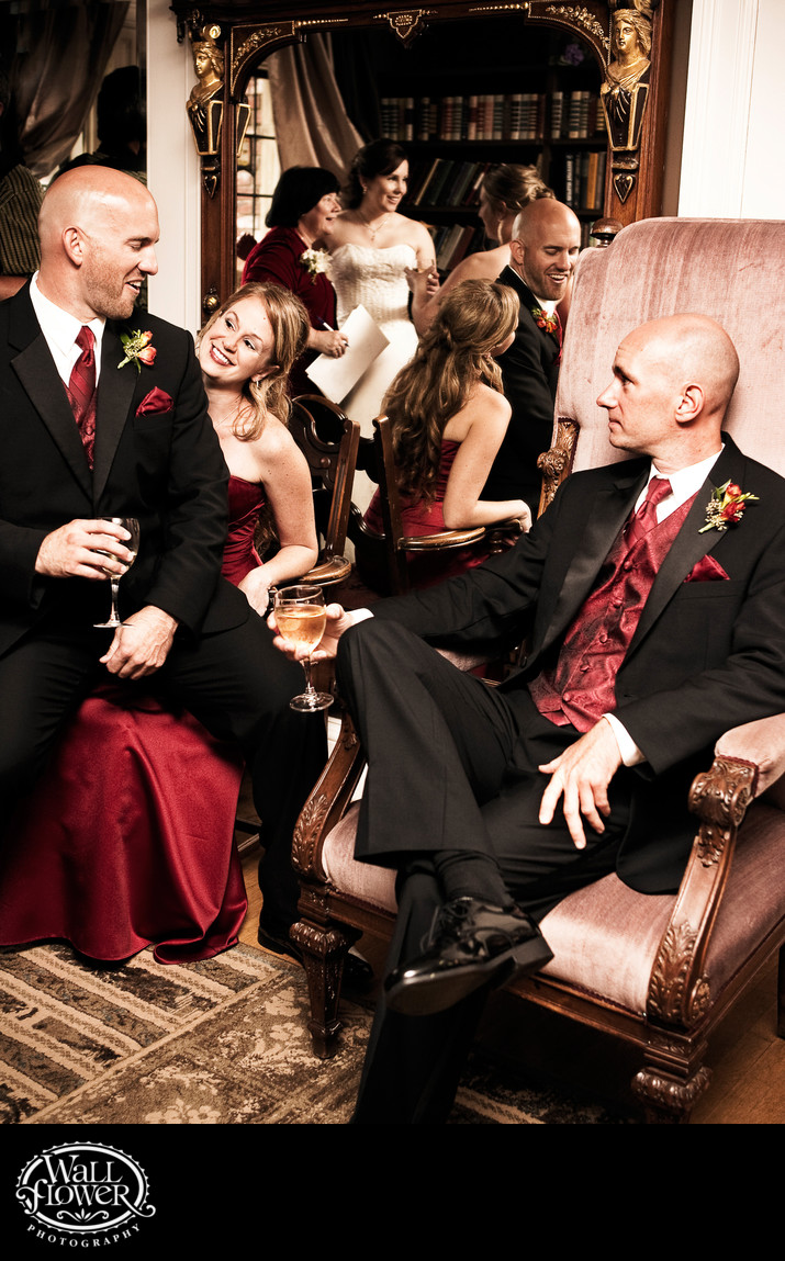 Wedding party chills in Thornewood Castle library between ceremony and reception