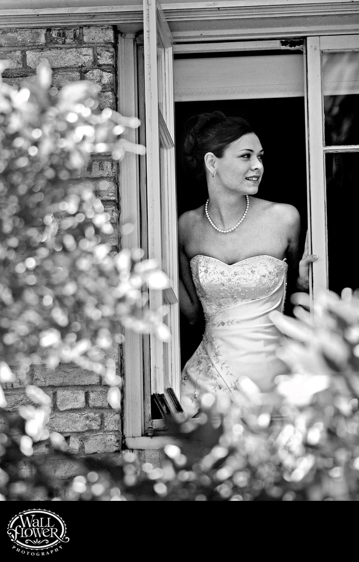 Bride looks out to ceremony site at Lakewold Gardens