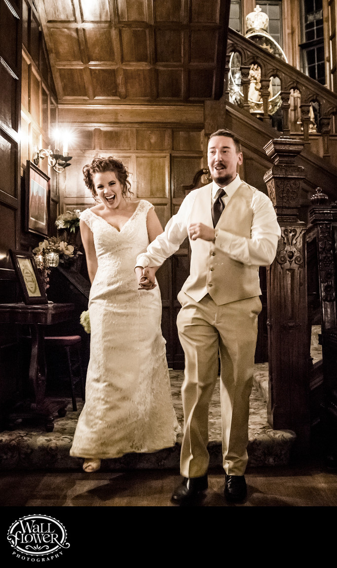 Laughing bride and groom in grand entrance to reception