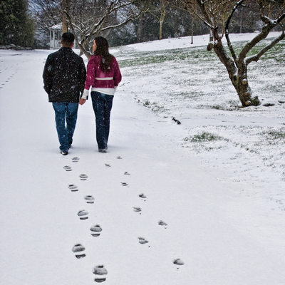 Engagement portrait walking in snow at Point Defiance