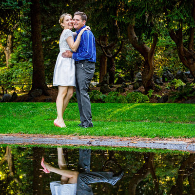 Engagement portrait with magical reflection in pond
