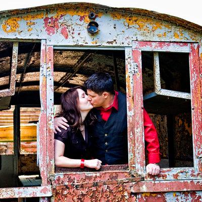 Engagement portrait in rusty train car