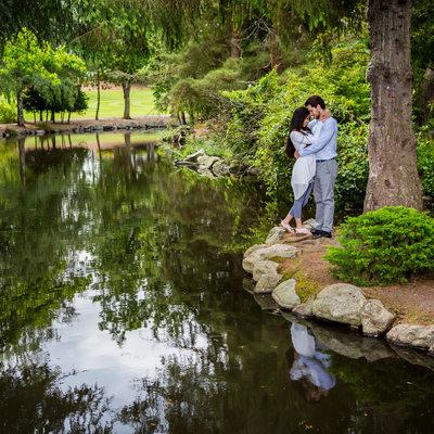 Engagement portrait by duck pond at Point Defiance Park