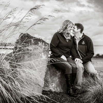 Engagement portrait nuzzle at Chambers Bay Golf Course