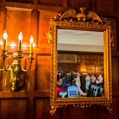 Wedding ceremony reflected in Thornewood Castle mirror