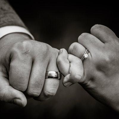 Detail of pinkie promise wedding rings
