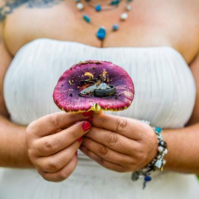 Detail of wedding rings on large purple mushroom cap