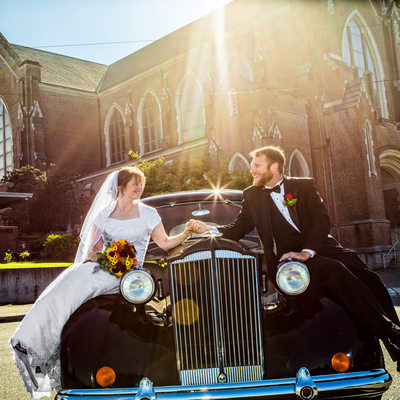 Bride and groom on Packard at Holy Rosary Church
