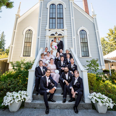 Wedding party sits on steps of St Paul's Church