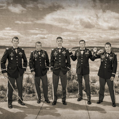 Army groom, groomsmen pose with swords at Chambers Bay