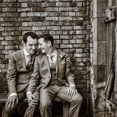 Two grooms on bench in Thornewood Castle sunken garden