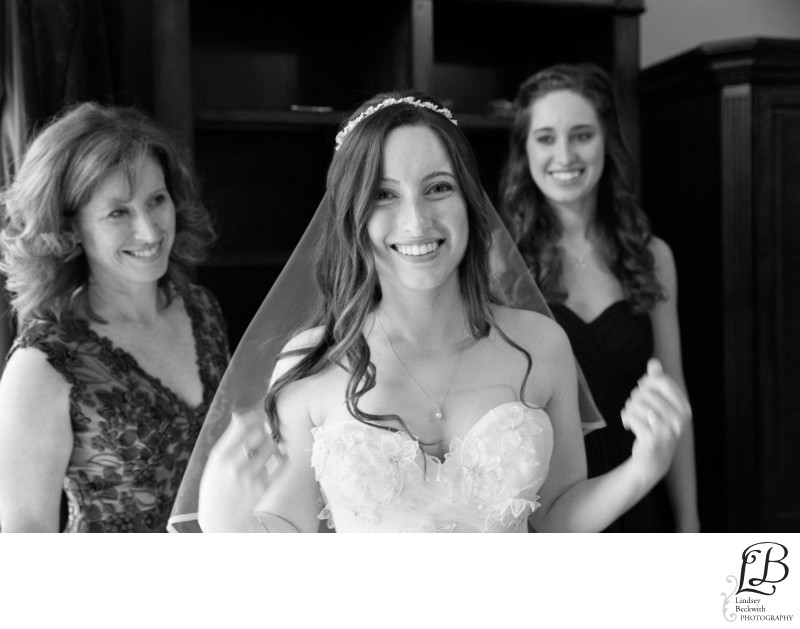 Mother and sister help bride get ready