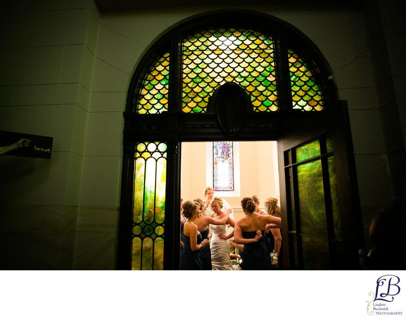 bride and bridesmaids getting ready at St. John Cantius