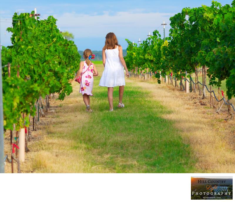 family portrait girls walking in Texas Hill Country Vineyard