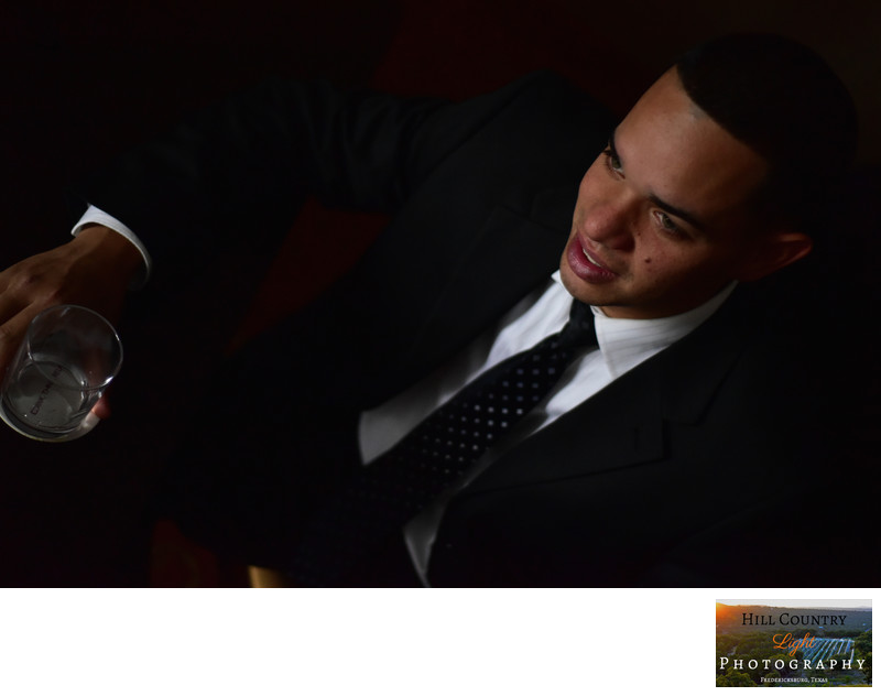 Groom portrait photograph scotch glass