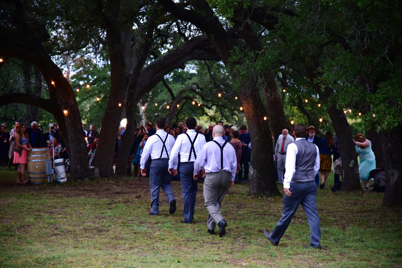 Grooms marching to the wedding ceremony William Chris Hill Country