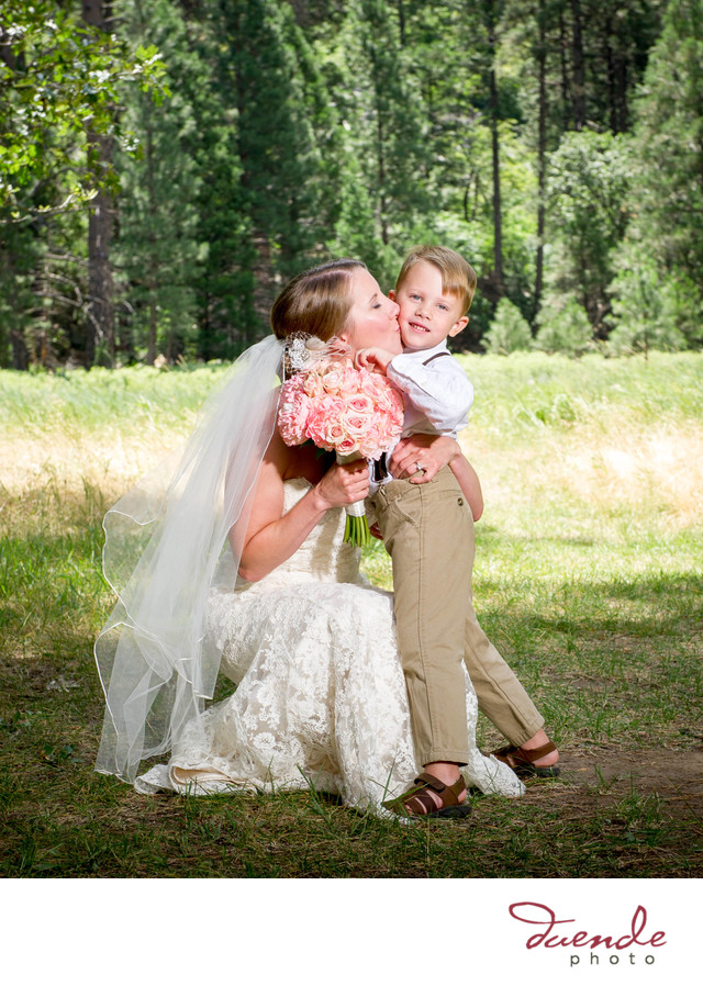 bride kissing ring bearer