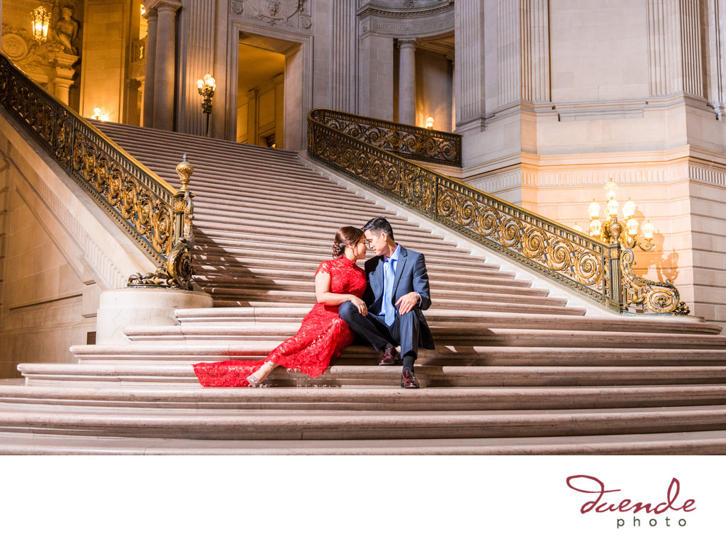 Bride and Groom seated on Grand Staircase City Hall
