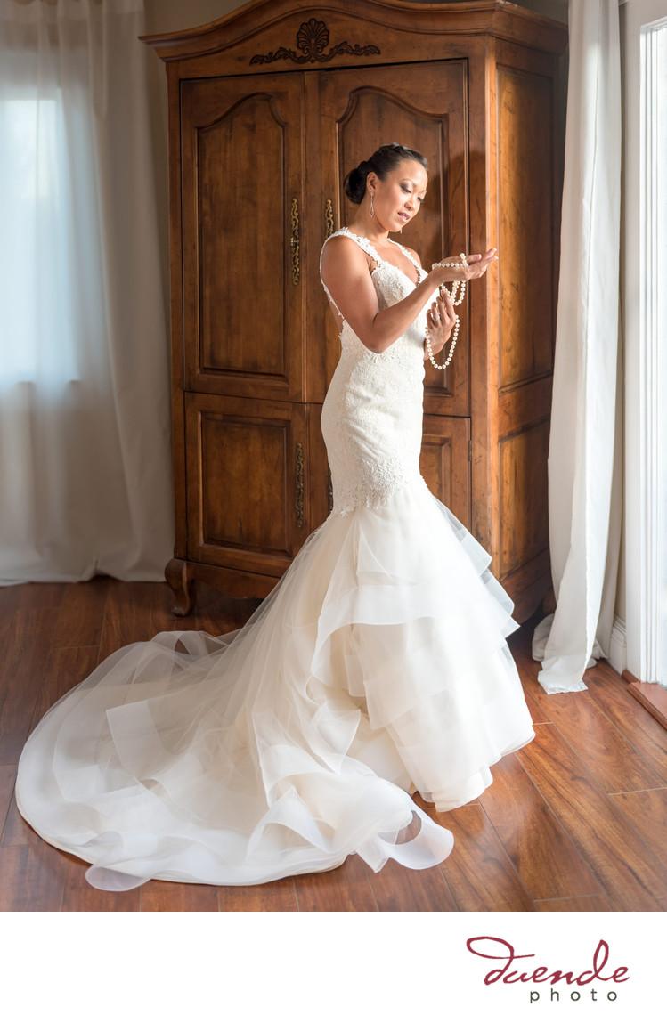 bride admires her jewelry