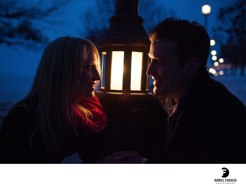 Engagement portrait by street lamp