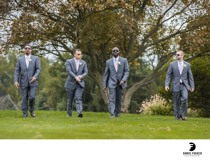 Photo of groomsmen walking at Penn Oaks Golf Club
