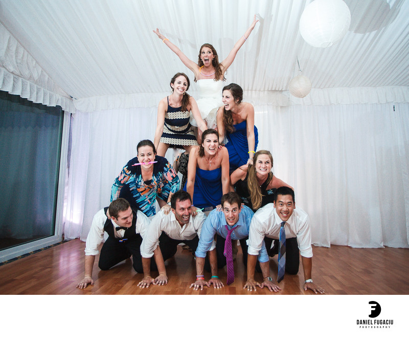 Cheerleader Pyramid made of wedding guests and bride on top
